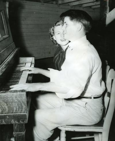 "Image annotated: ""Morrisen Culver serenading his date, Hawley Hall, 1950-51."""