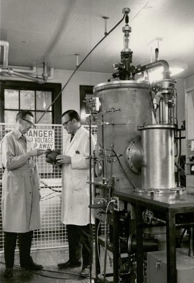 <p>Kenneth Hedberg (left), circa 1960. The machine pictured at right is an electron diffraction apparatus that Hedberg designed and built himself with the assistance of the OSC machine shop. It is still located in the</p><p>				basement of Gilbert Hall - only a handful of its kind remain worldwide.</p>