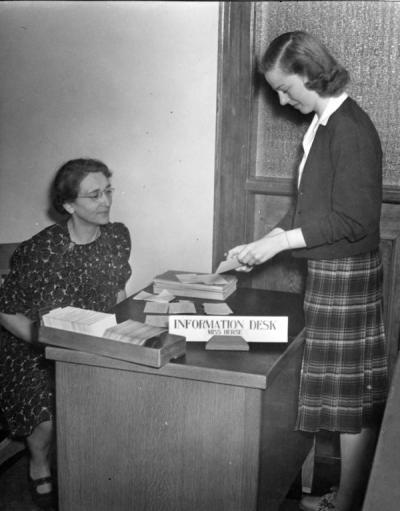 Bertha Herse and a student at the catalog room information desk on the second floor of the Library, later known as Kidder Hall, ca 1940s.