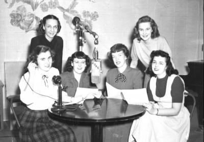 "Home Economics Club students participating in KOAC's ""Calling Mrs. Oregon"" radio program, 1950."