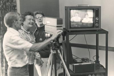 Glenn Klein providing instruction on how to use videotape equipment, 1980.