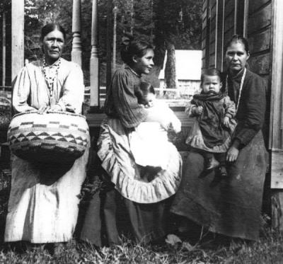 Siletz Indians, undated. From left to right: Mrs Bensell; Mrs. Mennard and baby; Mrs Ada Collins and son, Maxwell Collins.