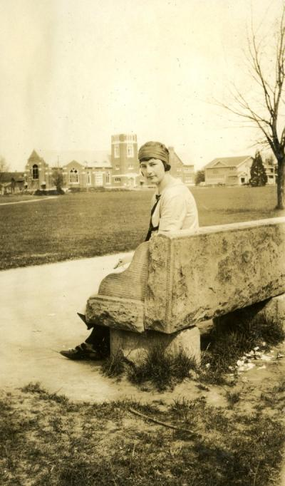Ruby Stafrin Irwin seated on the east end of the OAC campus, ca 1920s.