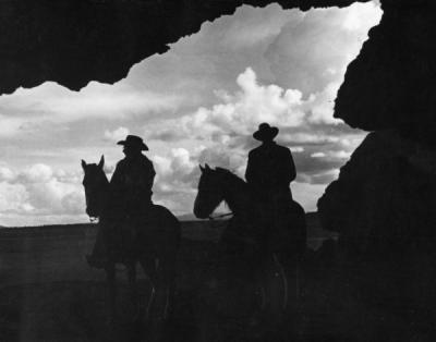 Cowboys at the entrance to Reub Long's cave, where sandals were found that were 10,000 years old, ca 1940s.