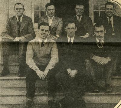 "Image from a  article titled ""Wage Wireworm War."" Caption reads: ""M. C. Lane and his crew."" Merton Lane is seated front row, center."