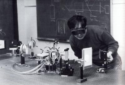 "<p>Image from a mechanical engineering booklet titled ""Oregon State University Mechanical Engineering - Our Faculty and Staff Heritage,"" October 1995. Photo caption reads ""Mach-Zehner interferometric study of heat transfer</p><p>				rates for natural convection in an open channel.""</p>"