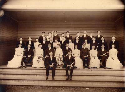 <p>Graduating class of 1900. From left to right: Front steps: Joseph Garrow, Herbert Junkin. First row: Eva Starr, Glenn Winslow, Garlin Hill, Scott Harris, Etta Smith, Dr. Burgess, Inez Fuller, Dilley, Dora Jackson, Hugh</p><p>				Penland, Elsie Reuter. Second row: Ed Aldrich, Teddy Palmer, Minnie Buxton, Fred Kruse, Arthur Frazier, Lillian Ranney, Lee Noel, Florence Maxfield, Fred Walters, Anna McBride, Albert Levens, Wilbur Carrow, John McBride.</p><p>				Back row: Harry Buxton, Joyce Hershner, Grant Elgin, Leita Ownsby, James McCaustland, Jake Saunders, Carle Abrams, Peck Bier, Jack Gallagher. Photo is property of J. H. Gallagher.</p>