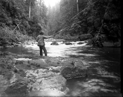 Unidentified man fishing in a stream, ca. 1900s.