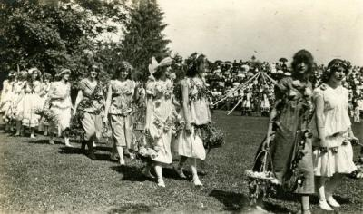 "A scene of maypole dancing. Original image is annotated: ""OAC dancing of folk dances by college girls,"" ca early 1900s."