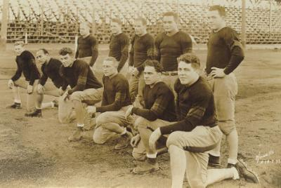 "The Ironmen, 1933. The Oregon State College football team earned national recognition as the ""Ironmen"" after playing University of Southern California to a 0-0 tie without making any substitutions. Schwammel is seen kneeling, second from the left"
