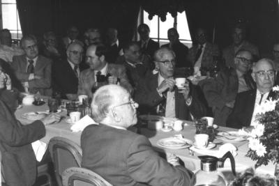 <p>Delmer Goode and Herman Scullen (far right) at the Triad Club head table, ca 1970s. Delmer Goode became Assistant College Editor in 1919, eventually serving as the Director of University Publications from 1943-1956. In</p><p>				1919, Goode founded Troop 1 of the Boy Scouts of America. Herman Scullen was a honey bee entomologist from 1920-1953. During Scullen's years in the Entomology department, the wasp collection increased dramatically. The</p><p>				Herman A. Scullen Memorial Fellowship was established for graduate studies in apiculture.</p>