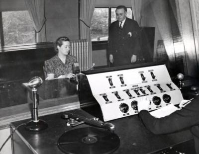 Shepard Hall speech studio; Dr. Mitchell stands at right. ca 1940s.