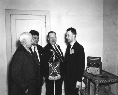 <p>New KOAC wire recorder in use at the Western Oregon Livestock Association meeting, December 1946. Pictured from left to right: R. C. Burkhart, Lebanon, retiring president of the organization; Albert Julian, Lyons, newly</p><p>				elected president; H. A. Lindgren, veteran extension animal husbandman; and Arnold Ebert, farm program director of KOAC. Lindgren served as the first president of the Steak and Chop Club.</p>
