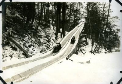 Unannotated image of a sledding outing, ca 1920s.