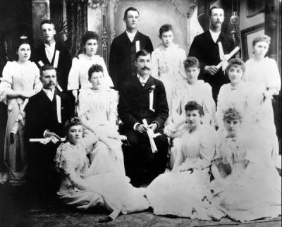 Oregon State College Graduating class of 1892. This class was the first to include home economics graduates. From Left to Right: front row - Lois Stewart Osborn, Martha Avery Fulton, Minnie Waggoner Lilly. Second row - John Fulton, Rose Horton Sheldon, James Storms, Lulu Chandler Eppinger, Leon Louis. Standing - Ida Ray Brandes, Charles Johnson, Nellie Davidson Wattenburg, Richard Scott, Nellie Hogue, Barney S. Martin, Anna Denman.