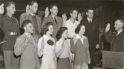 Associated Students at OSC, May 1941. Dean Gilfillan, far right, administers a loyalty pledge to the student body officers of OAC. Front row from left is: Andy Landforce, President; Jeanette Sims, 2nd Vice President; Adele Knerr, President of Associated Women Students; Dorothy McArthur, secretary. Back row: Taylor Charles White, yell king; Bill Teutsch, 3rd Vice President; Ken Robinson, 1st Vice President; Joe Ross, Barometer editor; Douglas Carter, Memorial Union president.