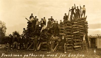 "Postcard annotated ""Freshmen gathering wood for bonfire."" Ca. 1910s."