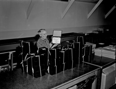 Eva Blackwell with diplomas, 1963. After graduating from Oregon Agricultural College in 1924, Blackwell worked in the Registrar's Office for more than 40 years until her retirement in 1965