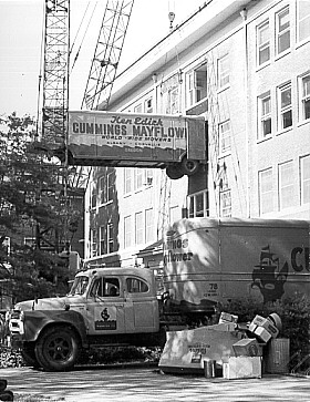 Microbiology Department moving from Agriculture Hall, 1970. The department moved to new quarters in Nash Hall designed specifically for microbiological work. Because Agriculture Hall had no elevator, cranes were used to lift the moving vans to the building's upper floors, where equipment and supplies were loaded onto the vans.