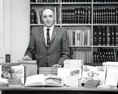 J. Kenneth Munford posing with OSU Press books, 1962. Munford received a degree in Education in 1934 from Oregon State College and from 1939-1941, he served as instructor for the English Department. In 1948 Munford became an editor for the Office of Publications, later being promoted to Director of Publications in 1956. He helped lead the founding of the OSU Press in 1961 and served as its first director.