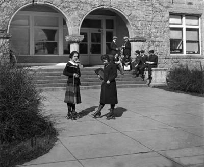 College co-eds rollerskating, early 1920s. From left: Jean Bates and Jean Folsom.
