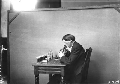 An unidentified O.A.C. student using a microscope, 1905.