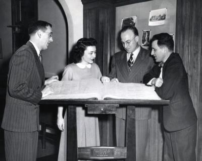 Left to right: Dan W. Poling, an unidentified woman, Ted Yerian and Fred Shideler.