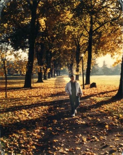 Unidentified student walking on the east end of the OSU campus, ca. 1990.