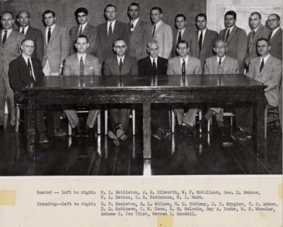 Forestry faculty group photo, January 1956. Tony Van Vliet stands back row, second from right. Seated (left to right): H. I. Nettleton, J. R. Dilworth, W. F. McCulloch, George H. Barnes, W. A. Davies, H. R. Patterson, W. I. West. Standing (left to right): R. F. Keniston, R. L. Wilson, M. D. McKimmy, J. T. Krygier, T. C. Adams, D. D. Robinson, C. W. Dane, R. M. Malcolm, Ray A. Yoder, W. P. Wheeler, Antone C. Van Vliet, Warren R. Randall.