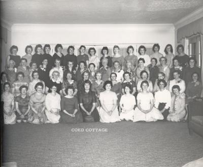 Mother's Weekend group portrait at the Co-ed Cottage, 1961. Darlene Olson (now Darlene Hooley) stands in the top row, right. Hooley graduated from Oregon State University in 1962.