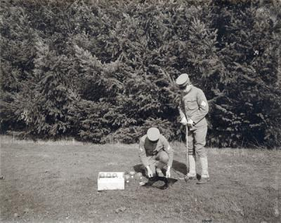 Students taking soil samples using a wire basket test, ca. 1909.