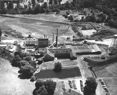 Aerial view of the Crown Zellerbach mill, log yards and holding ponds, 1949.