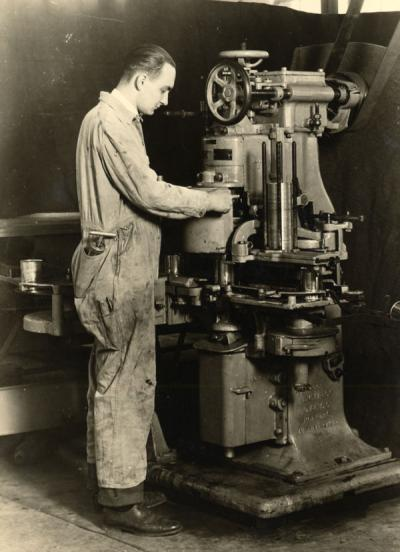 An unidentified man adjusting a Canco Machine at the OSC Canners Short Course, ca. 1930.