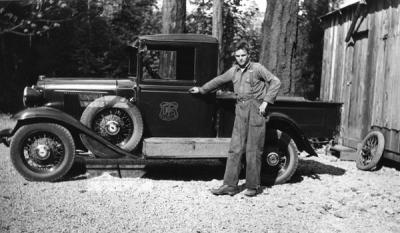 A Forest Service staffer posing with his truck at the Oakridge Civilian Conservation Camp F25, Co. 943, Willamette National Forest, 1934.