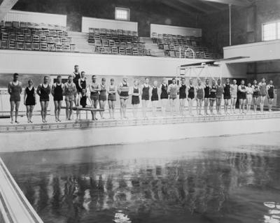 Swimmers at the Men's Gymnasium Pool, the first swimming pool built at the university, ca. 1920s.