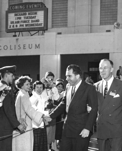 Vice President Richard Nixon shaking hands outside Gill Coliseum, escorted by John Gallagher, Fall 1954.