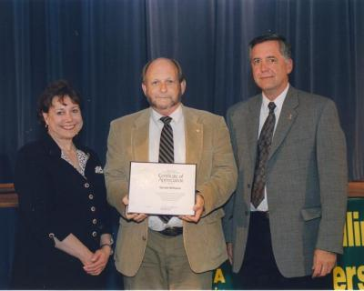 Gerald W. Williams (center) receiving a Certificate of Appreciation from Ann Veneman, U. S. Secretary of Agriculture, and Forest Service Chief Dale Bosworth.