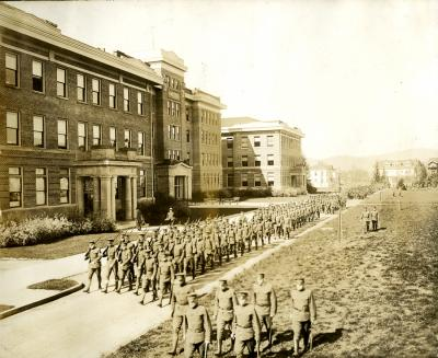 Oregon Agricultural College ROTC students marching adjacent to the Agriculture Building, ca. 1917-1918.