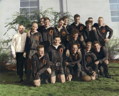 "Hand-colored team portrait of the OSU Rugby Club, 1964-1965. Original print is annotated: ""Wayne Valley, back row 3rd from right."""
