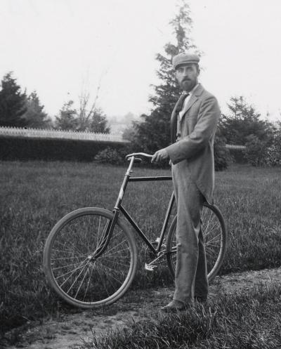 E.E. Wilson with a bicycle outside Benton Hall, circa 1900