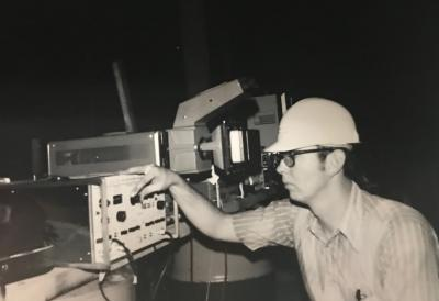 Zigler examining reactor equipment, 1973