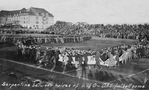 Fans serpentine at halftime of the Civil War football game, 1910.