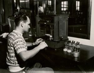 Robert Magee running a hops analysis sample, August 1950.