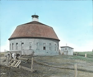 "Hand-colored lantern slide titled ""A modern dairy farm,"" ca. 1925."