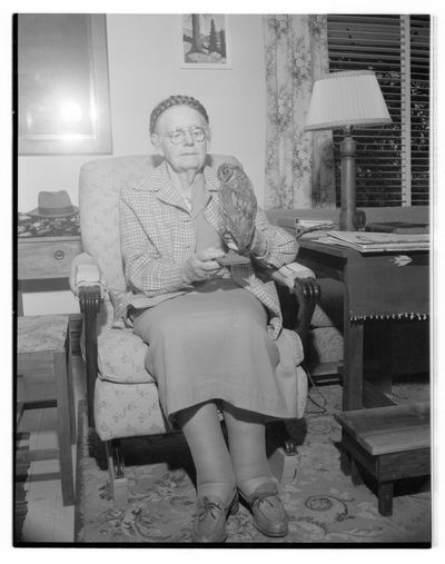 Grace French McCormick posing with a taxidermied owl_P082_02-2192.jpg