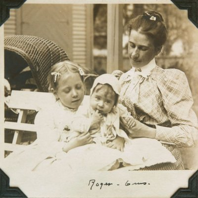 Black and white photograph of Hilda, Roger and mother Ina Hayward seated together on a bench.