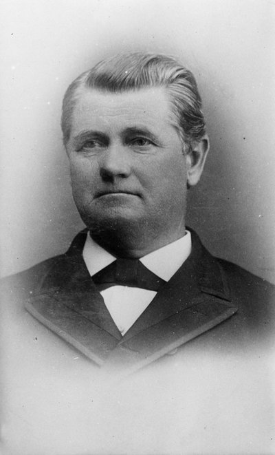 Black and white photographic portrait of Joseph Emery.