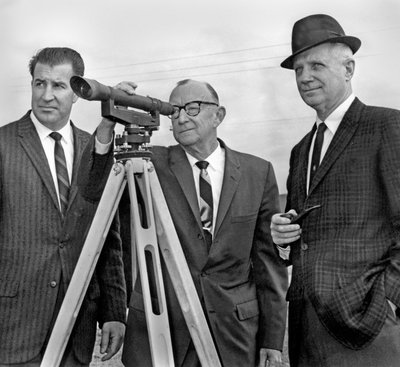 Black and white photograph of James Herbert Jensen with Cy Everts looking through a telescope.
