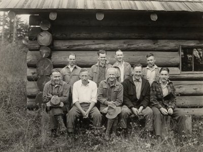 Black and white photograph of George Wilcox Peavy with forestry graduate students.