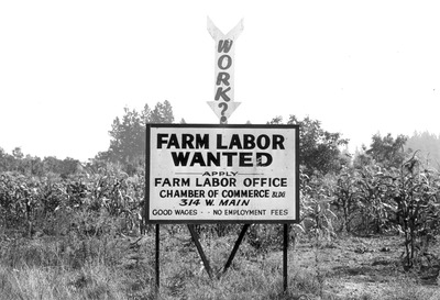 Photo of a billboard reading 'Farm Labor Wanted'